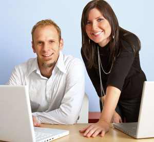 Man & woman working on website